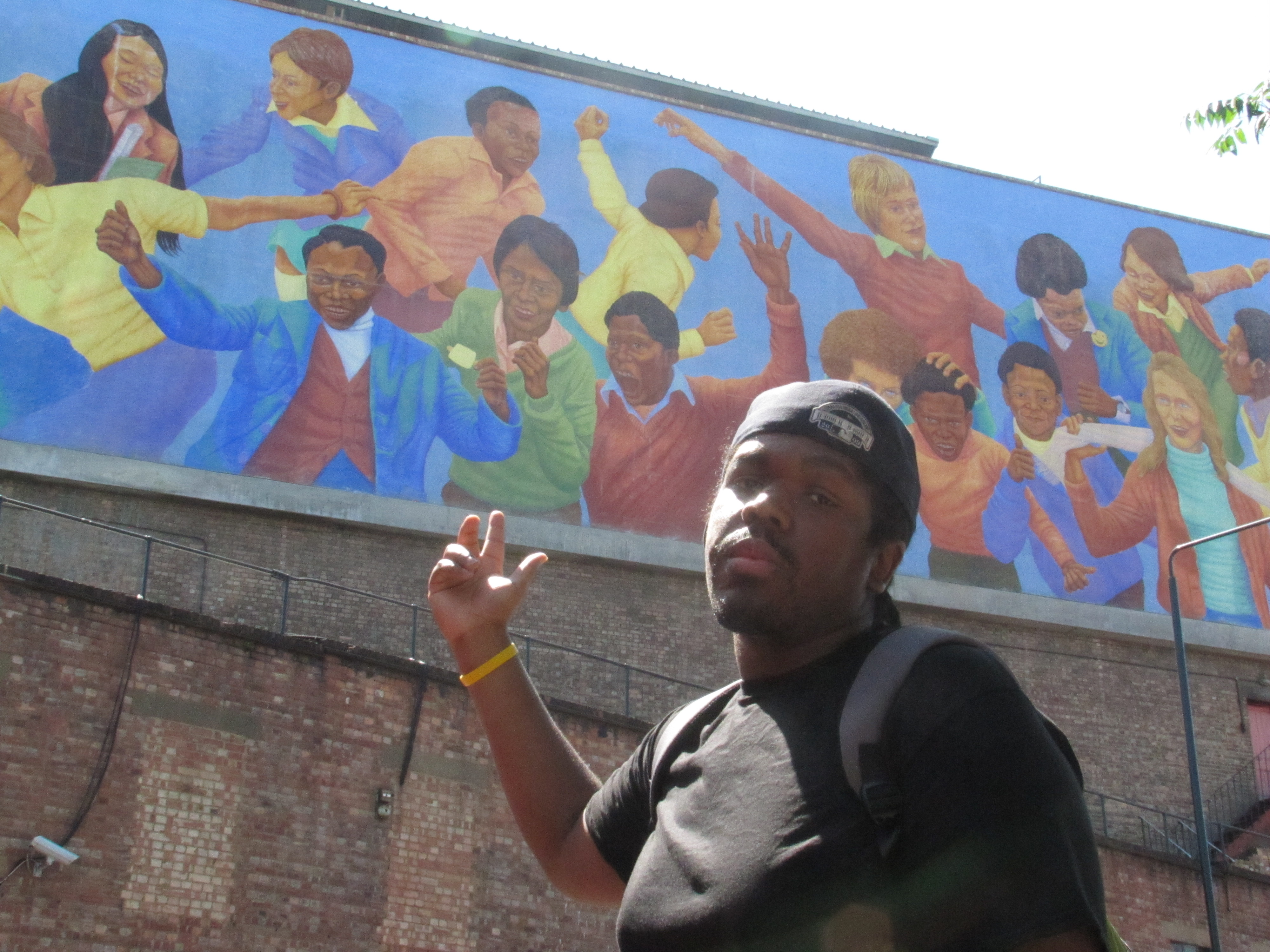 Chris Burns in front of a memorial to the Brixton Riots.