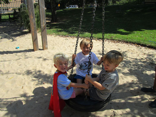 Children playing on swing.