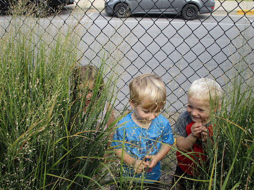 Children hiding in grass
