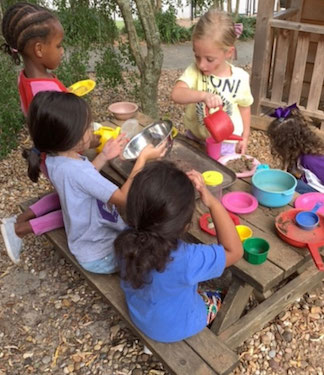 Pre Kindergarten children playing in sand