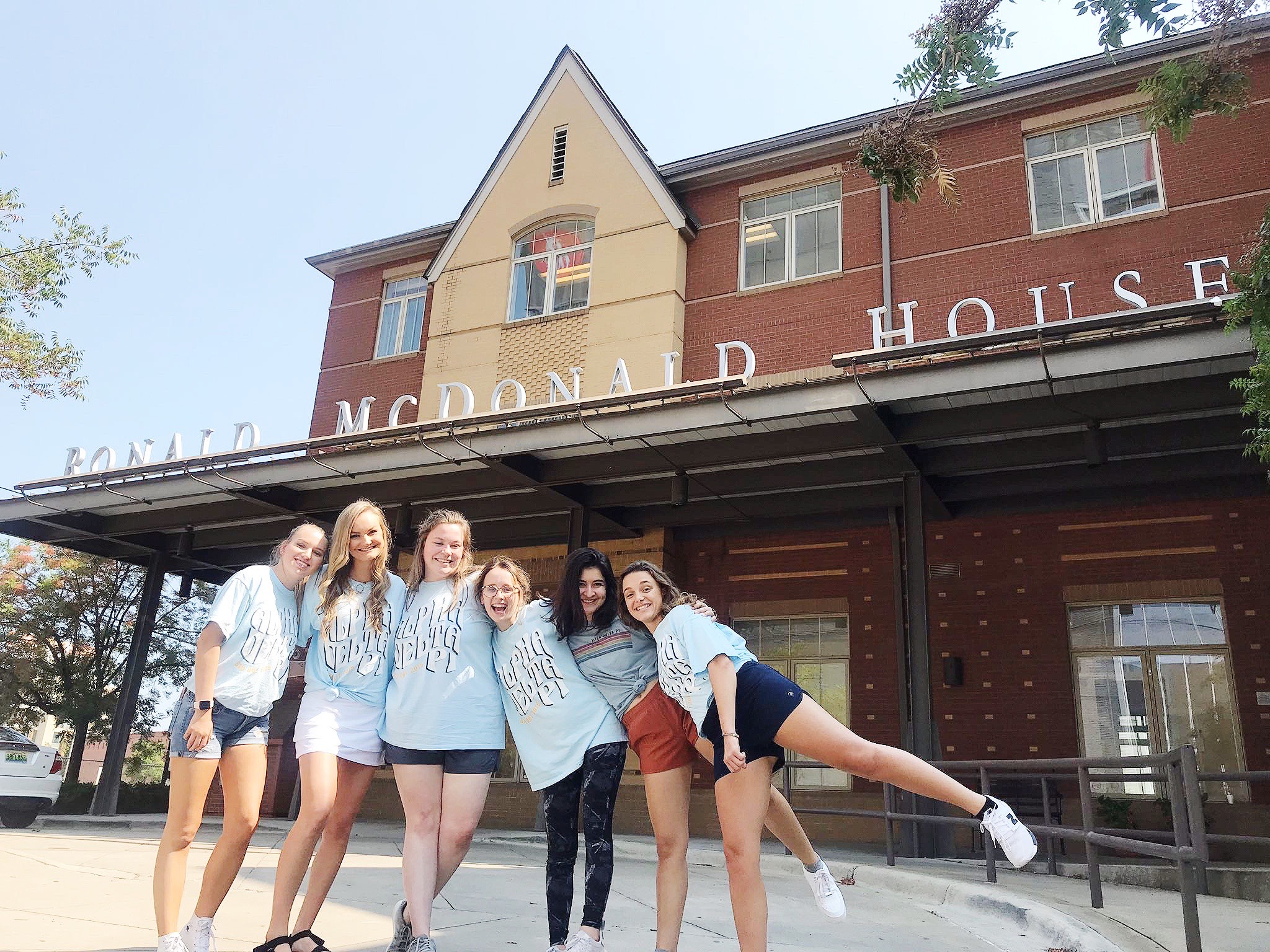 Members of Alpha Delta Pi pose for a photo outside of the Ronald McDonald House Charities.