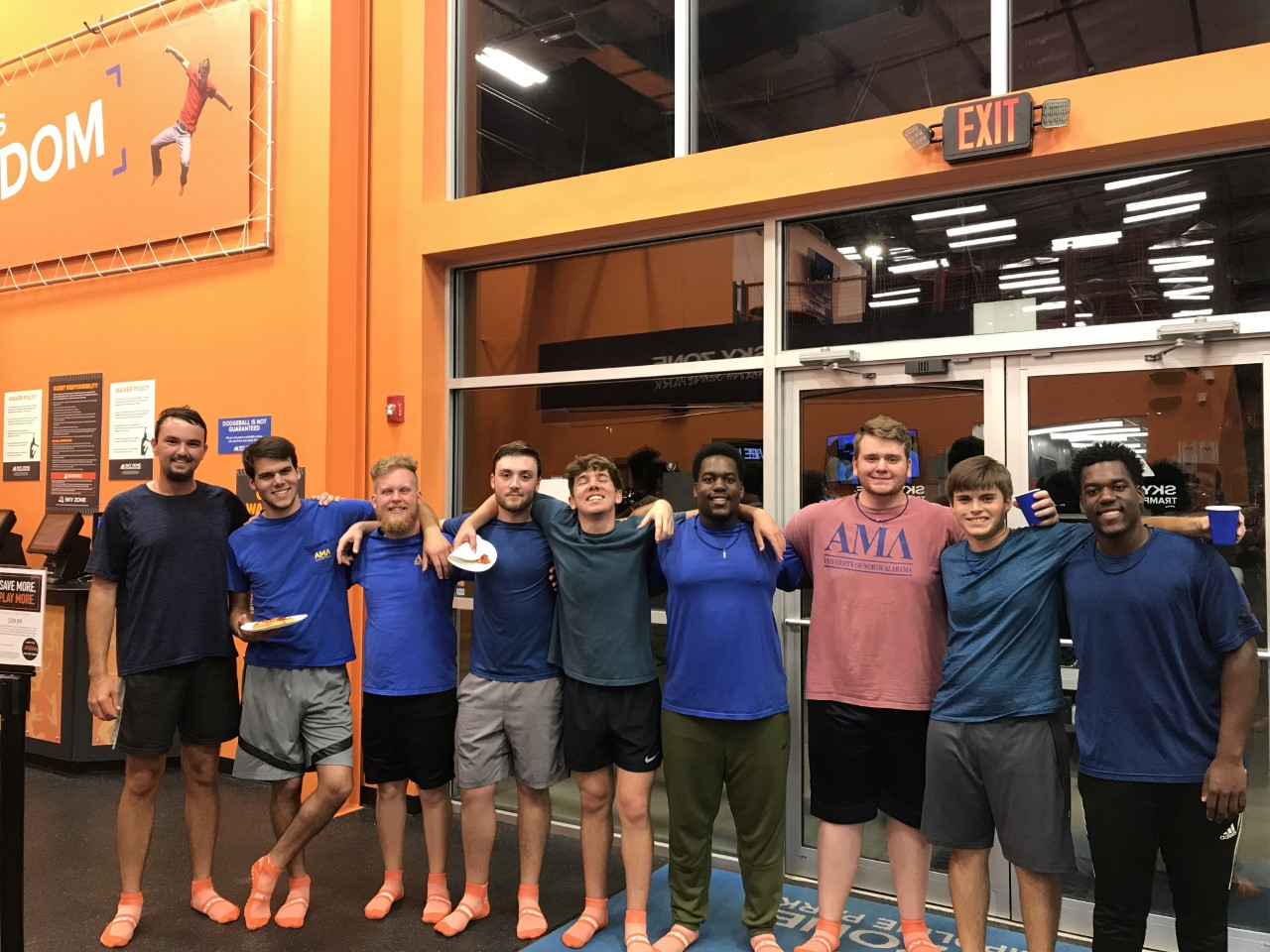 Members of AML smile together at SkyZone.