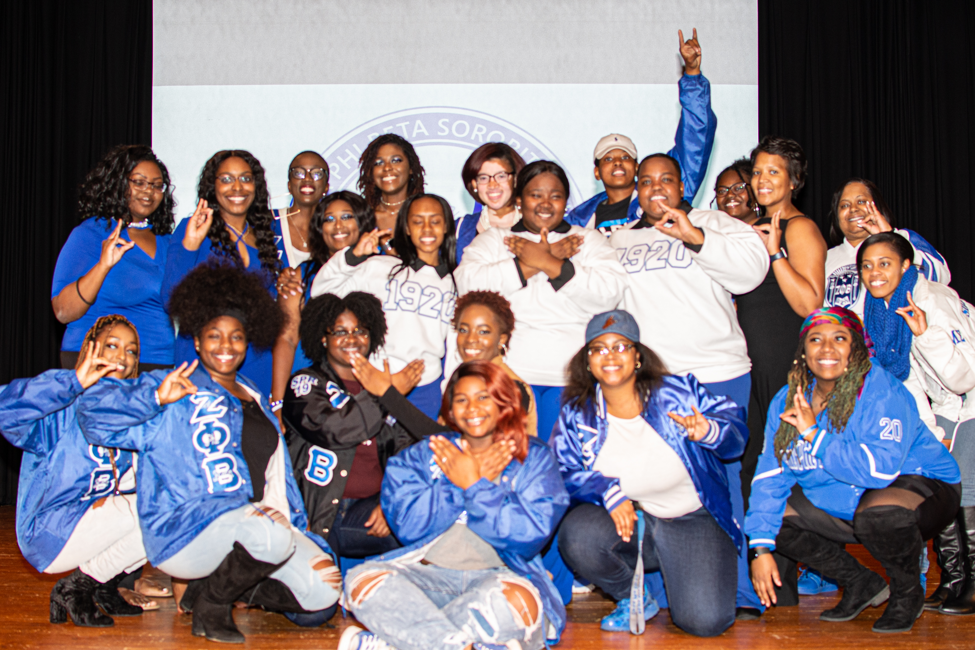 Members of Zeta Phi Beta Sorority, Inc. gather on stage for a group photo after their new member presentation.